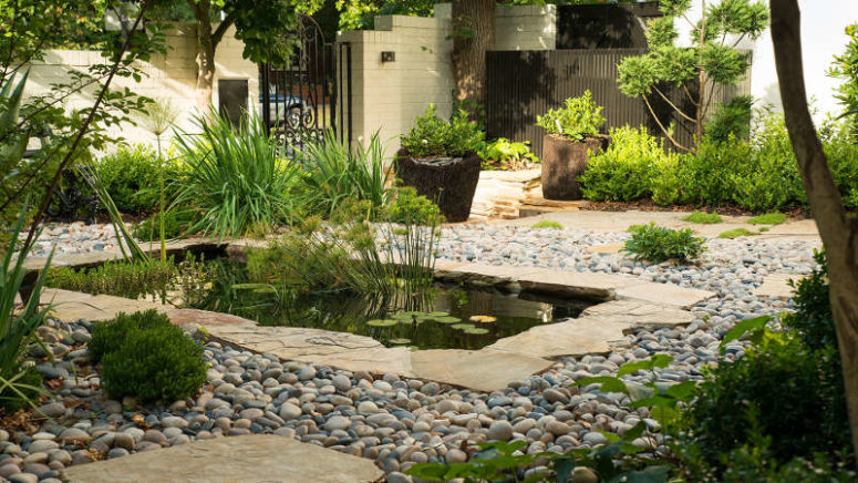 There's also a pond accentuated with pebbles and paving around