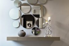 07 a circle wall mirror arrangement looks cool and modern, such an unusual decor idea