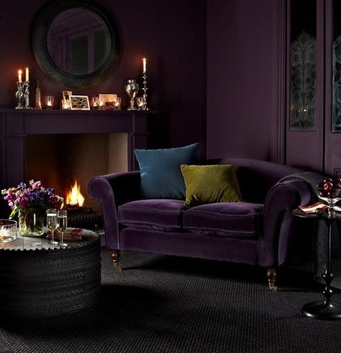 a deep purple velvet sofa for a moody space in purple