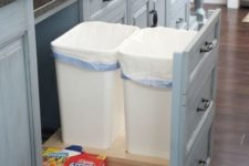 07 a pull out drawer with trash cans is a comfy solution that works for any kitchen
