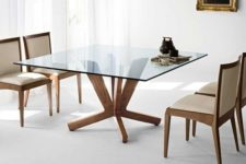 07 a square dining table with a glass tabletop and cool and stable wooden legs for a clean modern dining room
