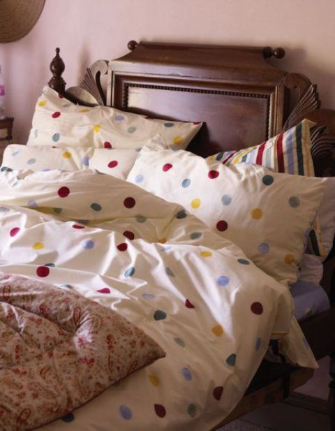 colorful polka dot printed bedding to add a cheery summer touch