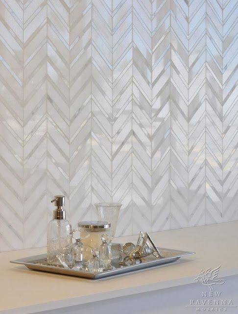 mother of pearl tiles clad in a chevron pattern for a refined bathroom