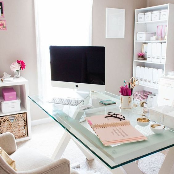 white wooden trestle legs and a glass tabletop for a cute modern girlish home office
