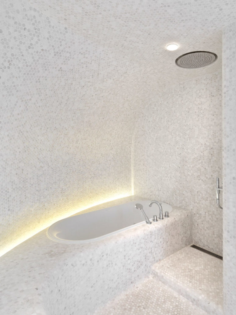 Curves make the space feel like a spa, and marble tiles help with that