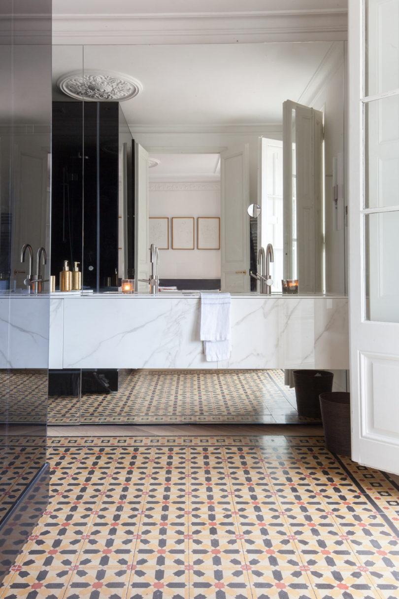 The bathroom is clad with white marble, which makes it super luxurious