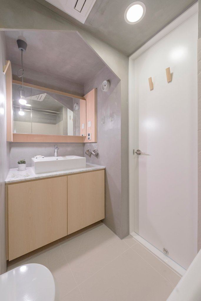 The bathroom is done in concrete and plywood, it's small and functional