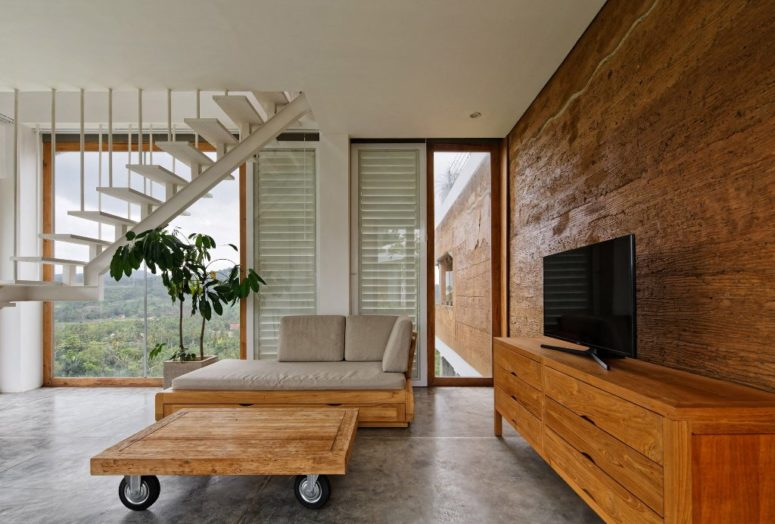 The inner decor on the whole is a unique mix of minimalism and industrial style, there's much wood including bamboo, which is a local material