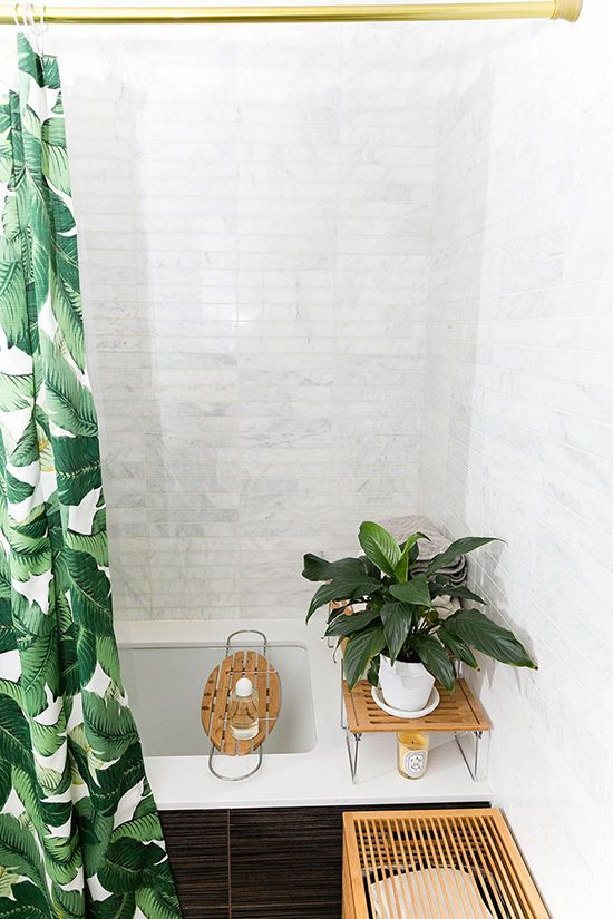 a banana leaf shower curtain will make your bathroom feel like outdoors