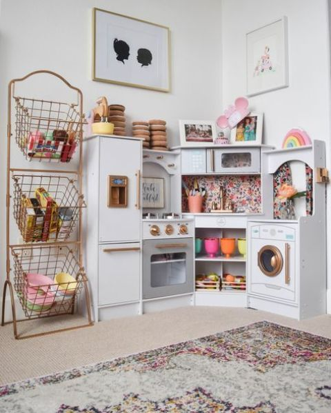 a play kitchen nook as a part of a playroom