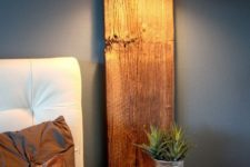 08 a rustic floating nightstand with a wooden plank attached to the wall and a horizontal part