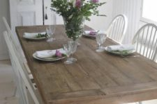 08 a whitewashed shabby chic dining room is enlivened with a large wooden trestle dining table