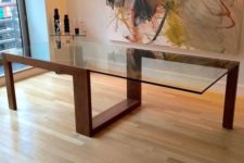 08 modern sculptural table with a creative geo wooden frame and a large glass table top