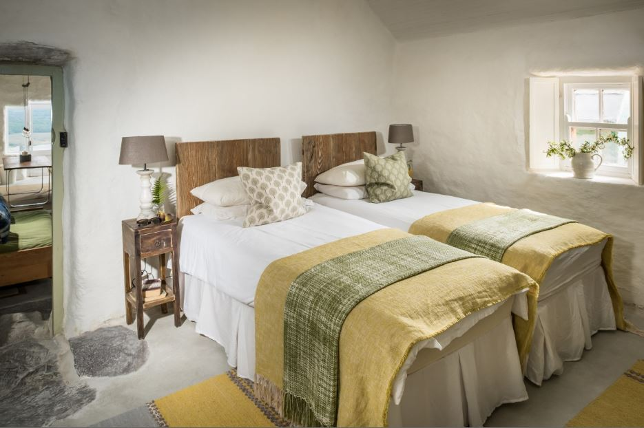 The beds and bedside tables are rustic and vintage at the same time