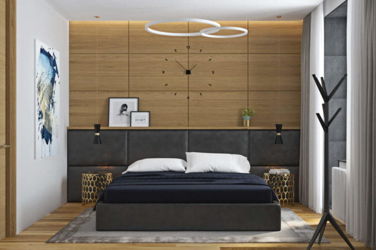 The master bedroom features a wooden clock wall, an extended leather headboard and a leather upholstered bed