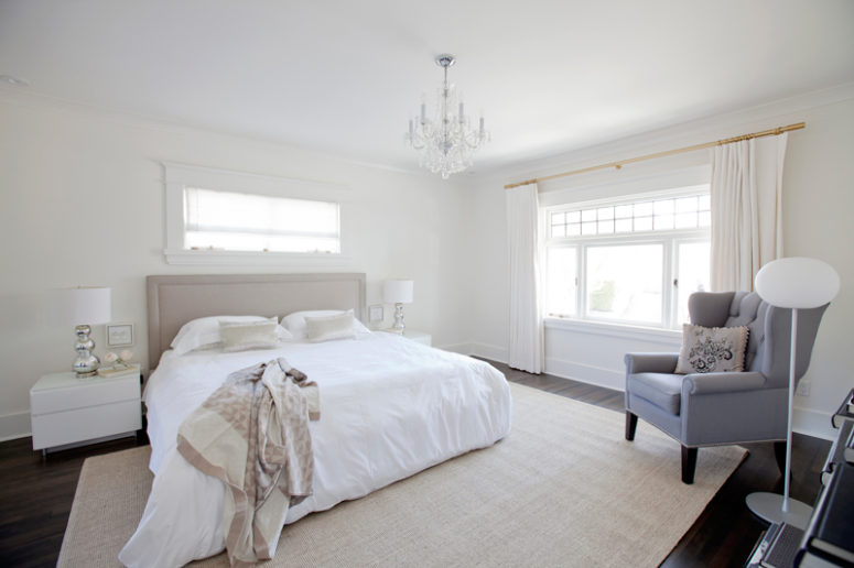 The master bedroom is filled with neutrals and soft textiles, which make it welcoming