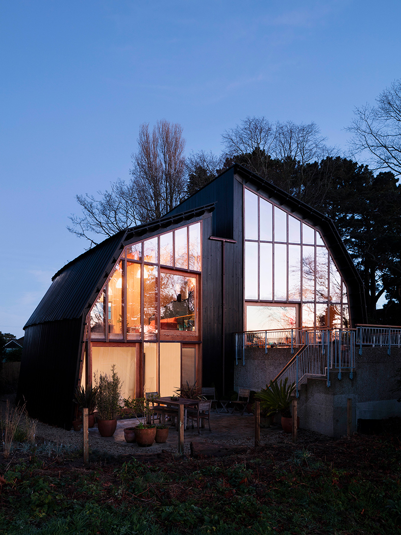 This is how the poperty looks at night, I totally love the lines and glazings that offer sea views