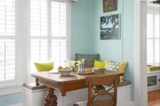 09 a dark stained wooden trestle table adds a vintage rustic feel to this small breakfast nook