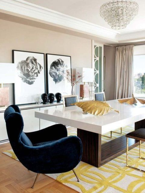 a mid-century modern dining space in neutrals with yellow accents and a chic comfy navy velvet armchair