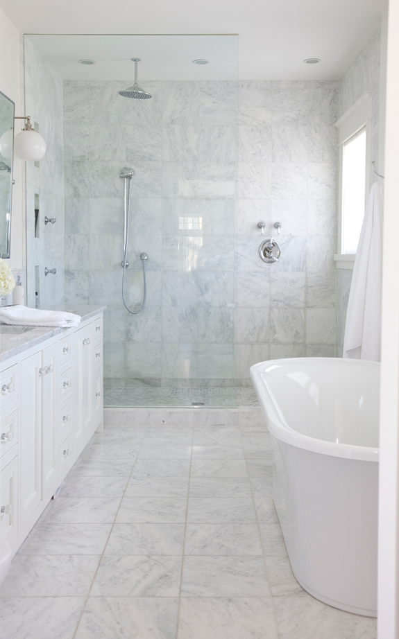 The first bathroom is clad with white marble, it's very luxurious and elegant