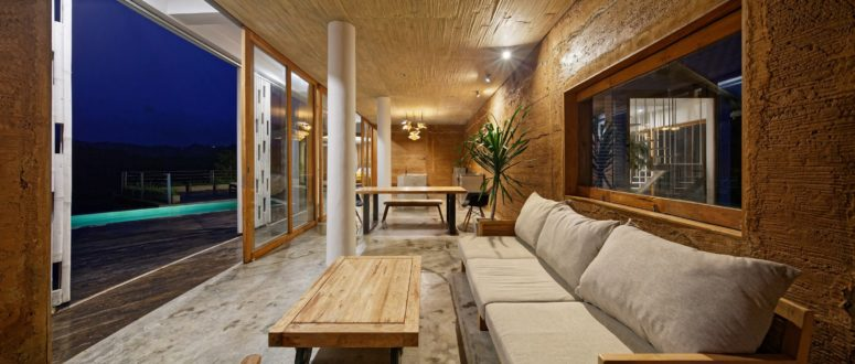 Wood, metal and concrete are used to finish the interiors, and there's some light-colored upholstery, too