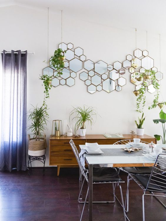a hex framed mirror arrangement is a cool and eye-catchy decoration for this space