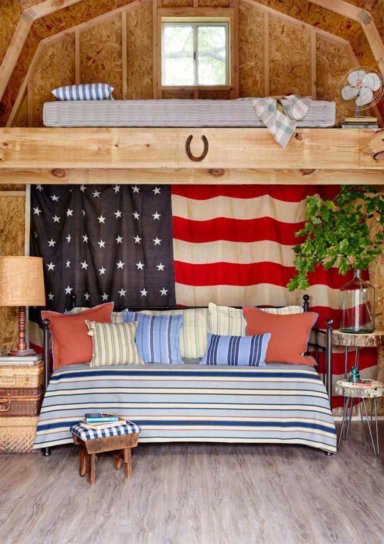 a living room and bedroom decorated in patriotic style, with cozy traditional furniture
