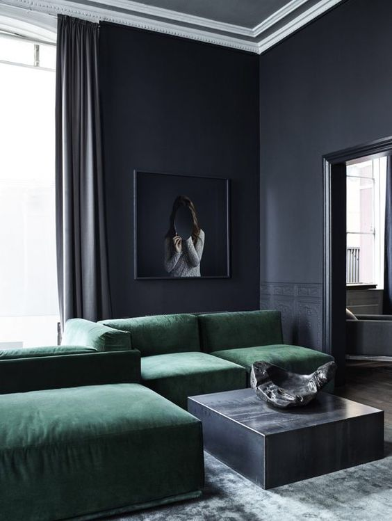 a minimalist moody space in graphite grey and emerald velvet sofas looks eye-catching