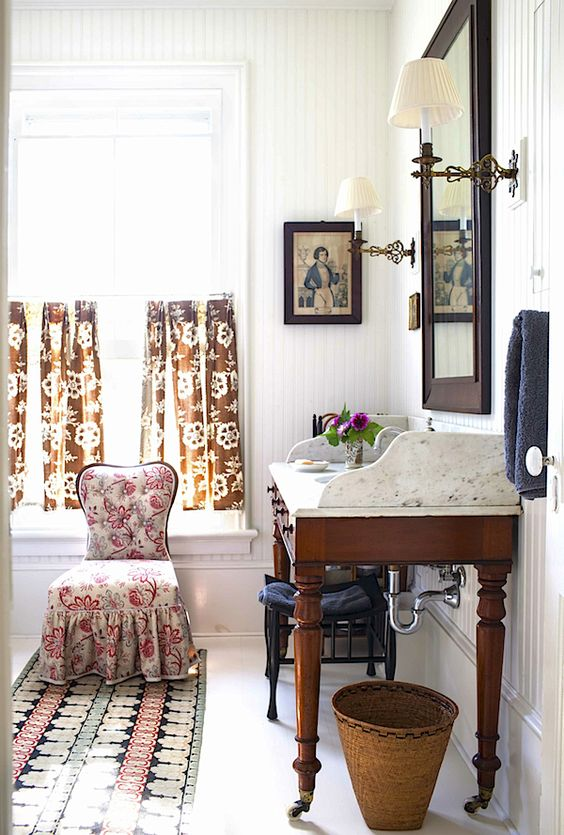 a vintage desk placed on casters and with a new top for a vintage-inspired bathroom