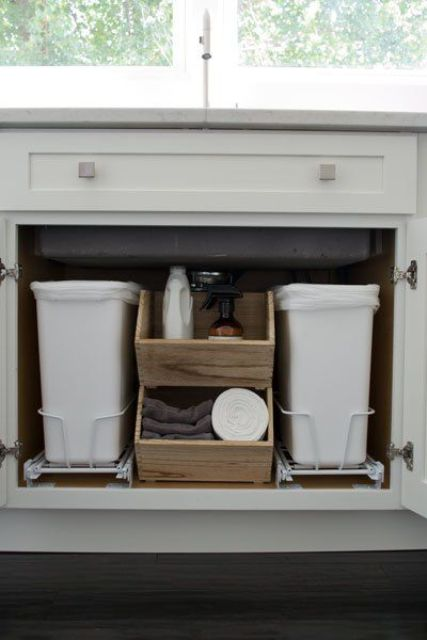 29 sneaky ways to hide a trash can in your kitchen digsdigs Kitchen under cabinet storage ideas