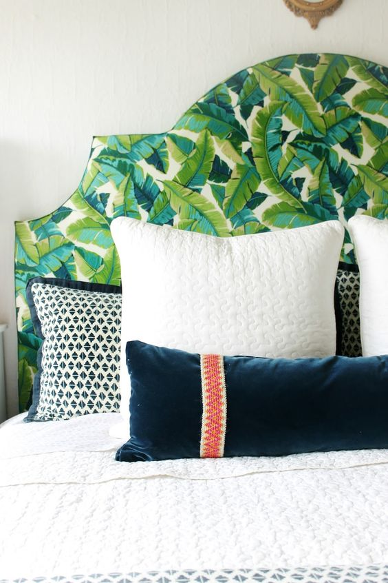 upholster your headboard with banana leaf print fabric to make it bolder and more eye-catchy