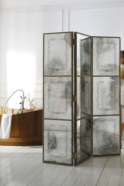 a refined faded mirror space divder used to make the bathroom more stunning