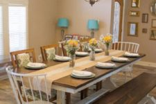 11 a rustic dining space with a wooden tabletop and white legs and a matching bench looks cozy and intimate