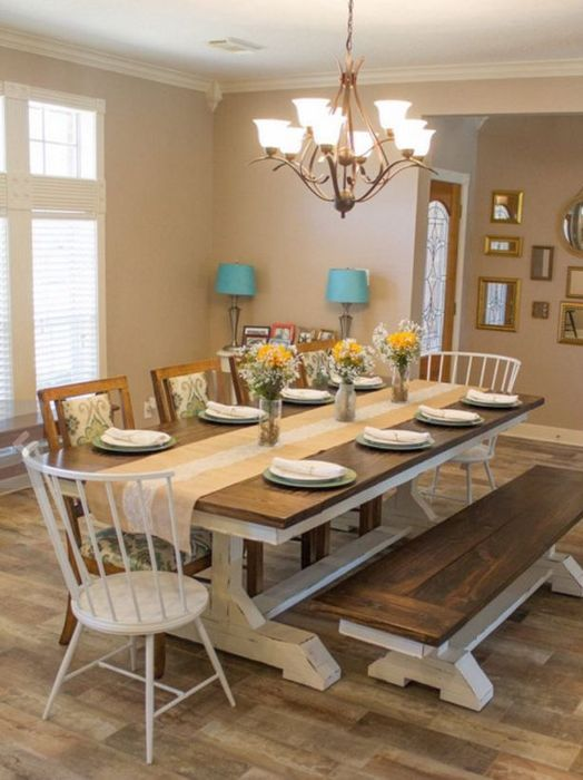 a rustic dining space with a wooden tabletop and white legs and a matching bench looks cozy and intimate