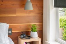 11 an open wooden box storage shelf for bedside storage