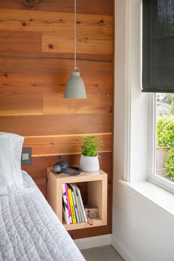 an open wooden box storage shelf for bedside storage