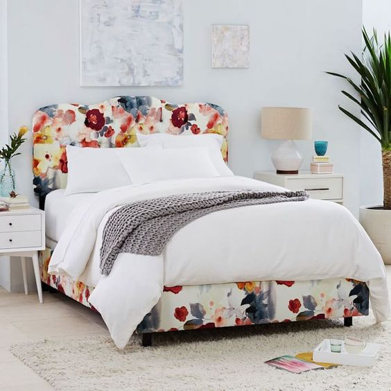 make your bedroom cozier and cuter upholstering the whole bed with floral fabric