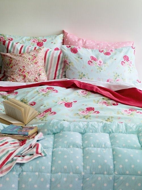 mint blue, white and pink bedding set with polka dots, floral prints and stripes