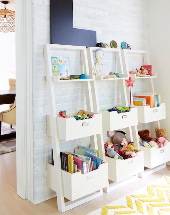 white shelving units with open shelves and boxes look nice and are comfy in using