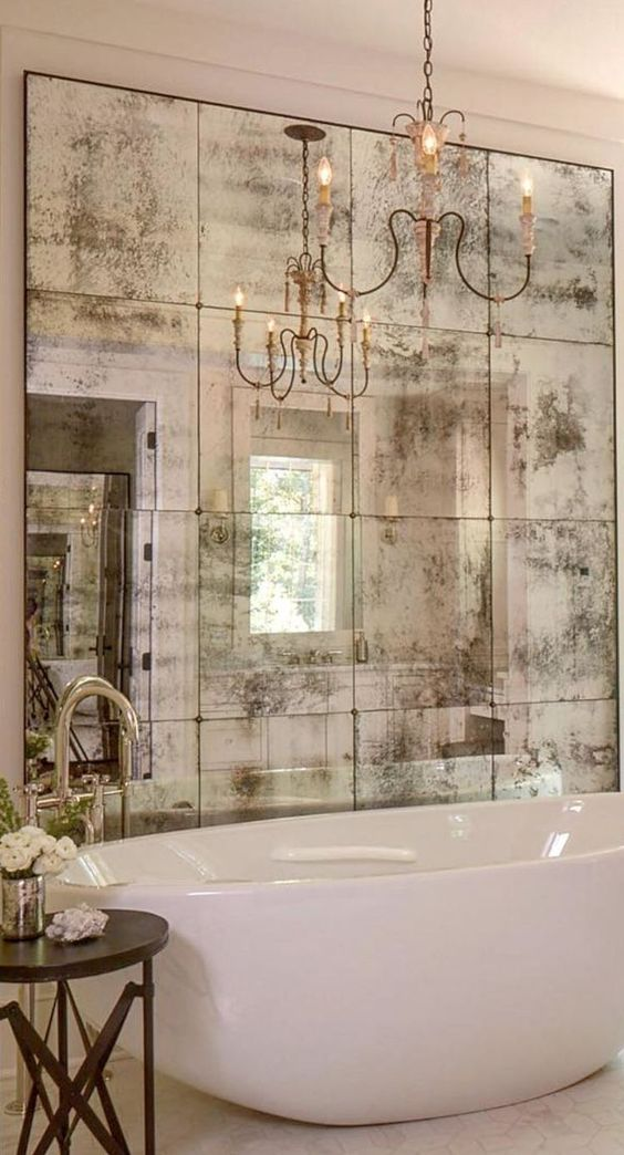 an artfully faded mirror is all that is necessary to create a vintage feeling at home