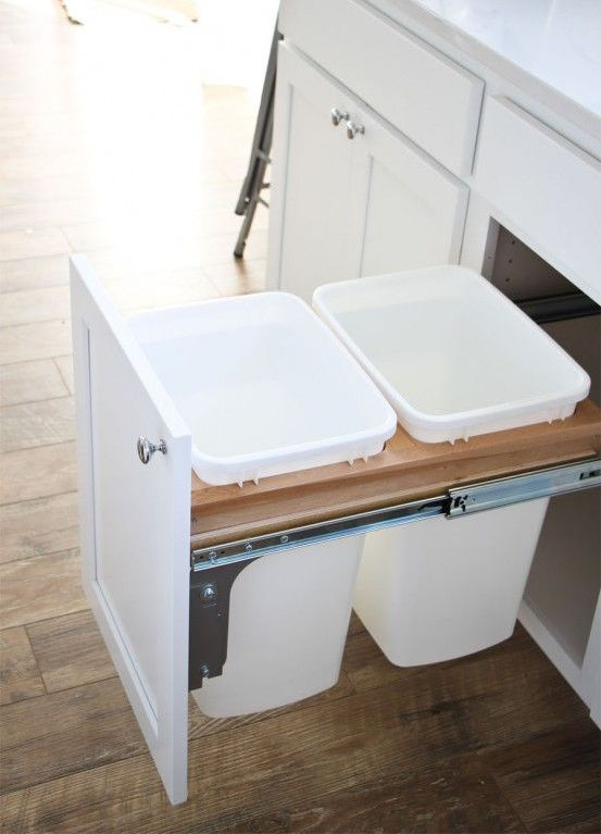 pull out trash cans hidden inside a kitchen cabinet