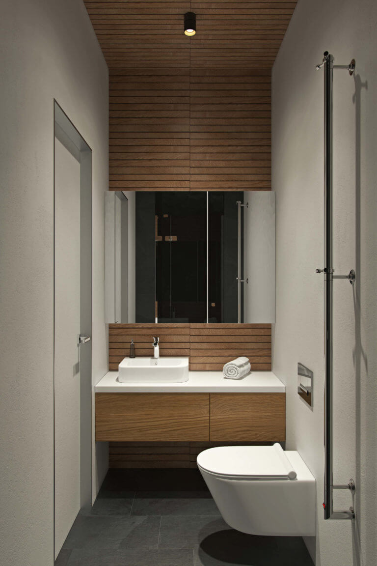 The second bathroom is done in light grey and with the use of natural wood