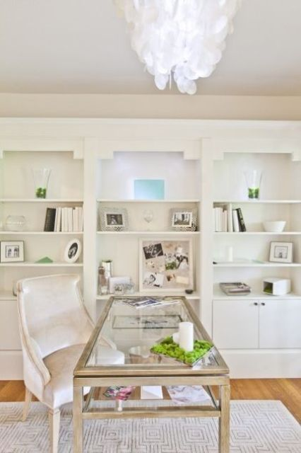a glass desk with a double tabletop and wooden framing - such a smart storage idea