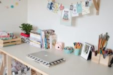 13 a kid's study space with a light-colored trestle desk, which has storage compartments