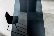 13 a minimalist glass and wood table with a smoked glass tabletop looks chic and edgy