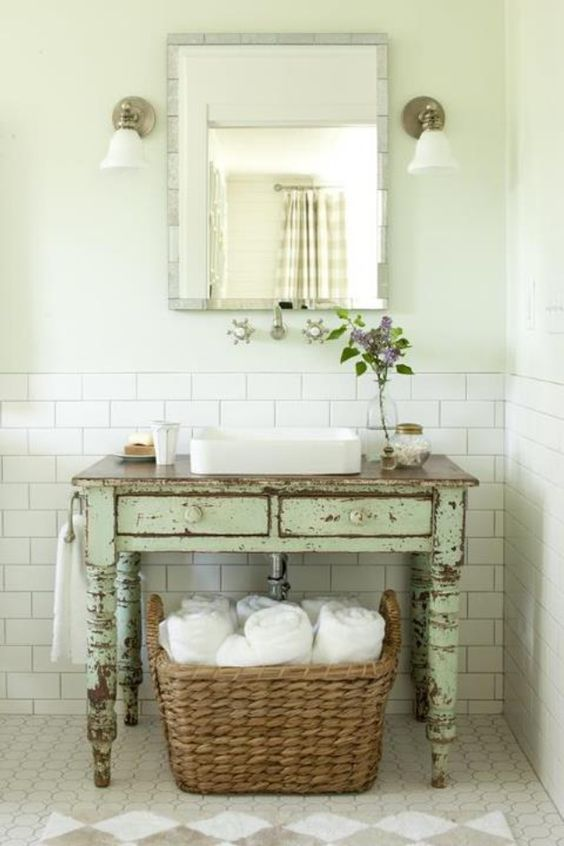 a mint-colored shabby chic desk to use as a bathroom vanity to make the space more rustic and shabby