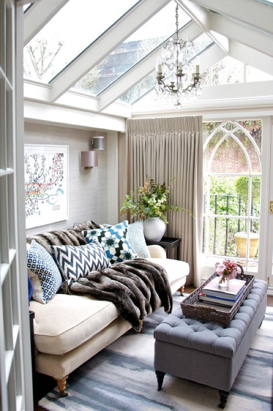 a she shed decorated as a cozy living room, with soft textiles and faux fur