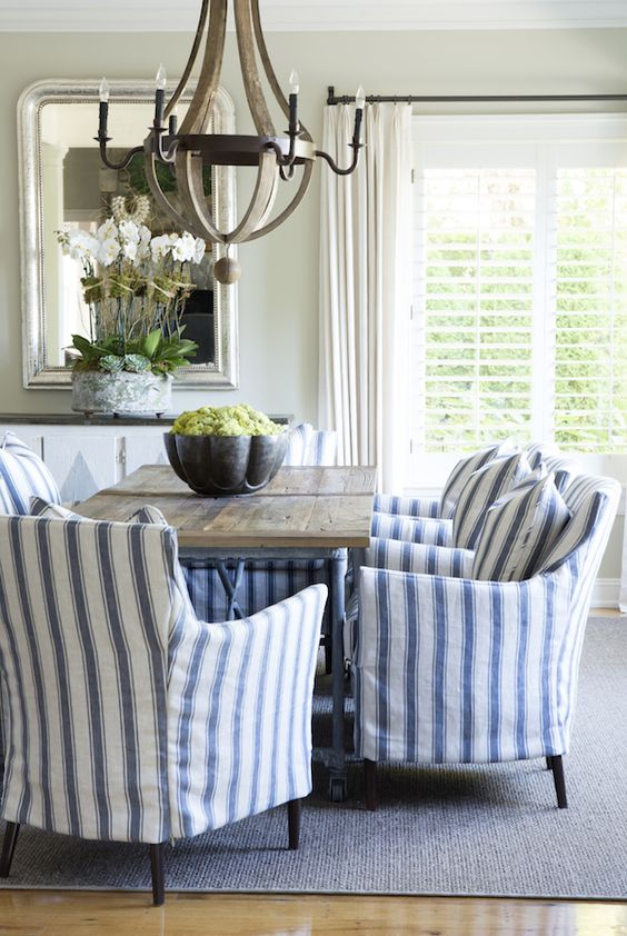 a traditional cottage dining room with blue and white striped armchairs for comfort and chic