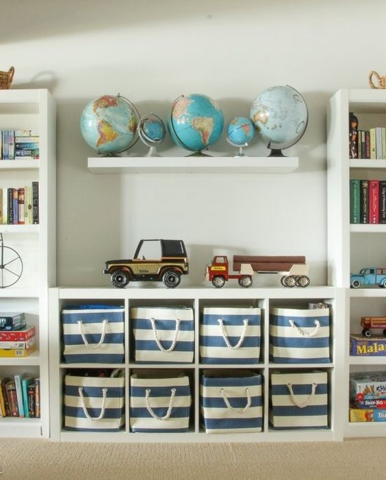 insert fabric boxes into an open shelving cabinet to declutter the space
