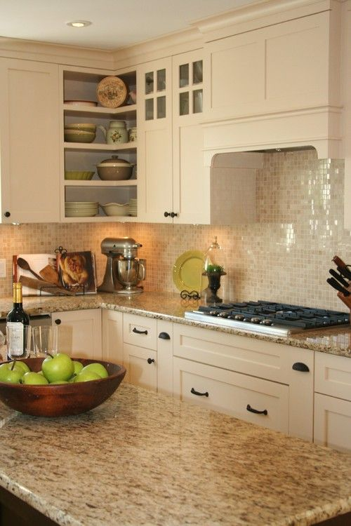 shiny mother of pearl backsplash tiles for sprucing up a creamy kitchen
